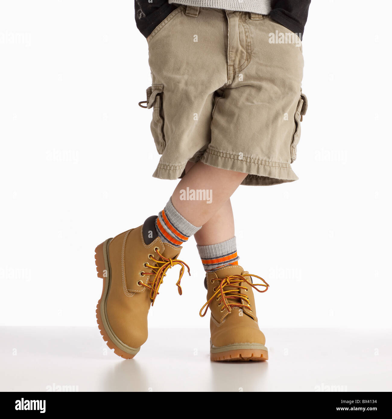 A Boy Wearing Work Boots - Stock Image