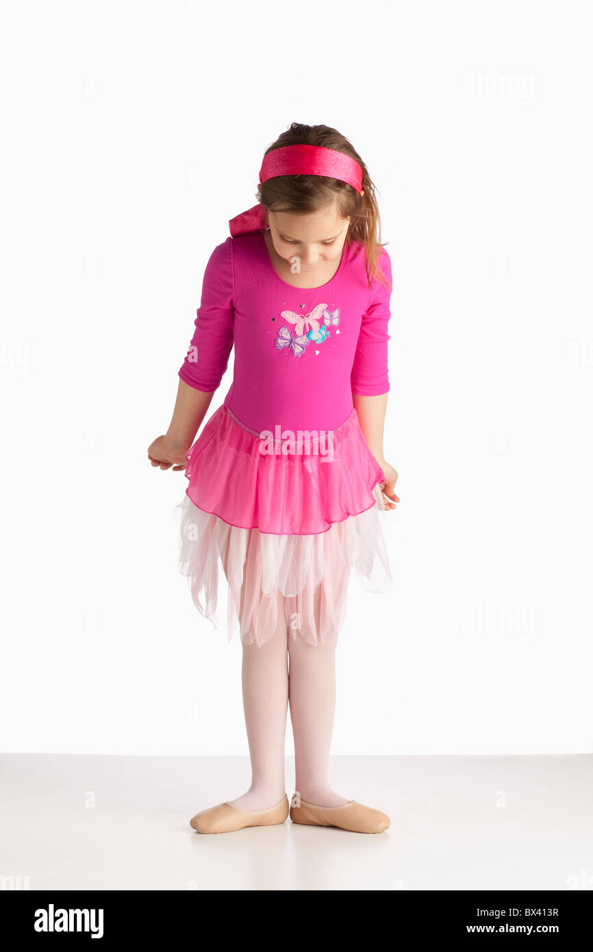 A Girl Wearing Ballet Shoes In A Ballet Pose Stock Photo