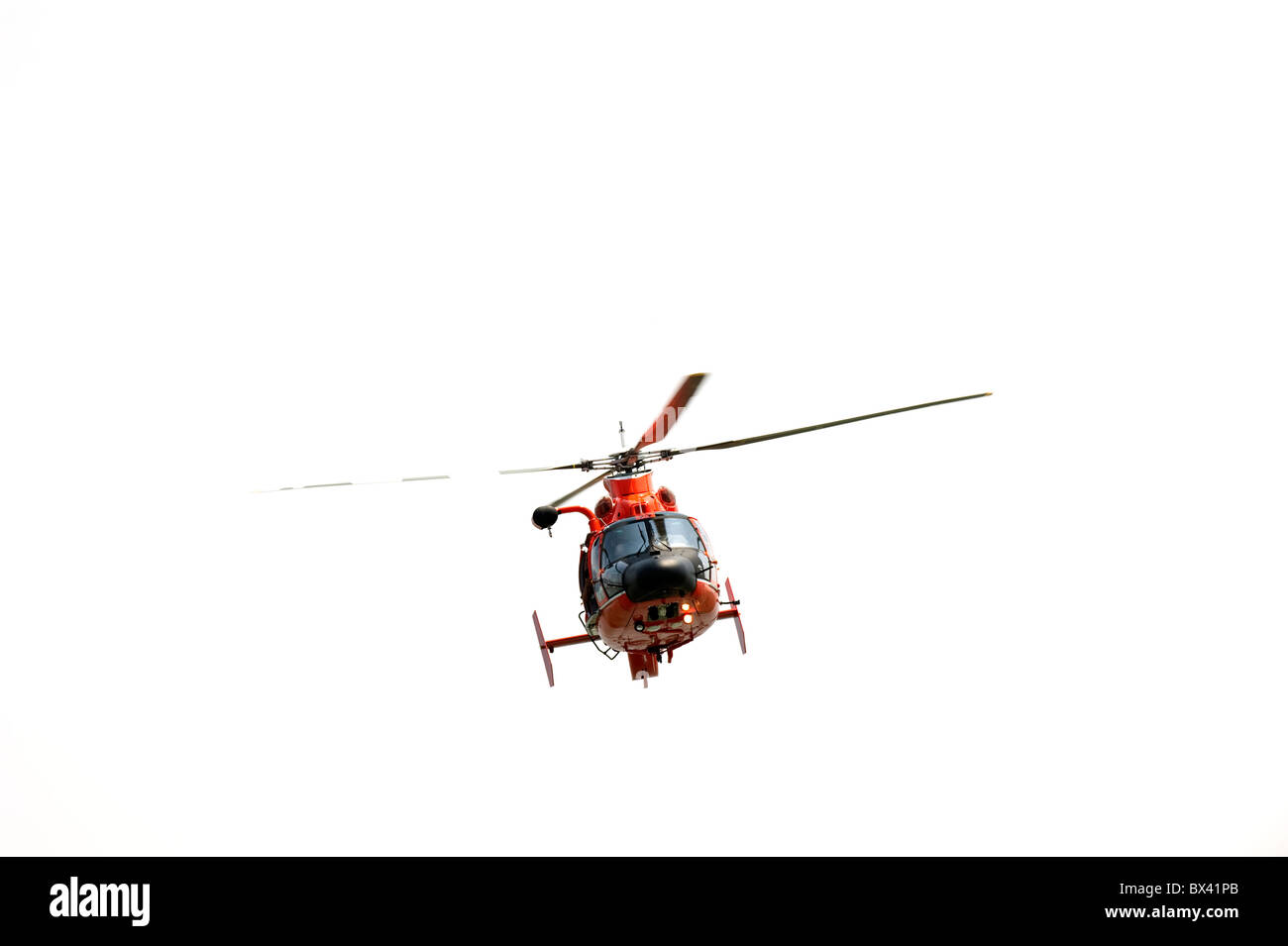 High resolution photograph of a red helicopter isolated on white Stock Photo