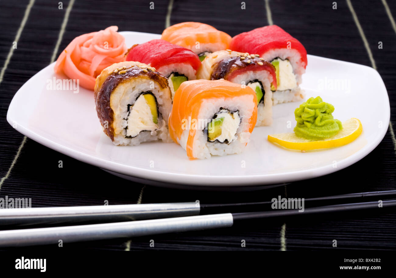 Image of maki sushi rolls served with wasabi - Stock Image