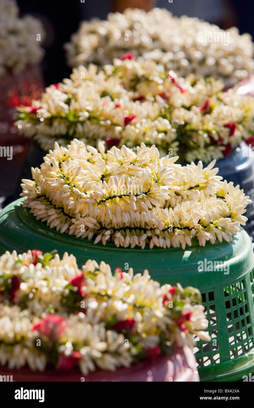 Garland Of Flowers Displayed On Top Of Baskets; Sathyamangalum, Tamil Nadu, India - Stock Image