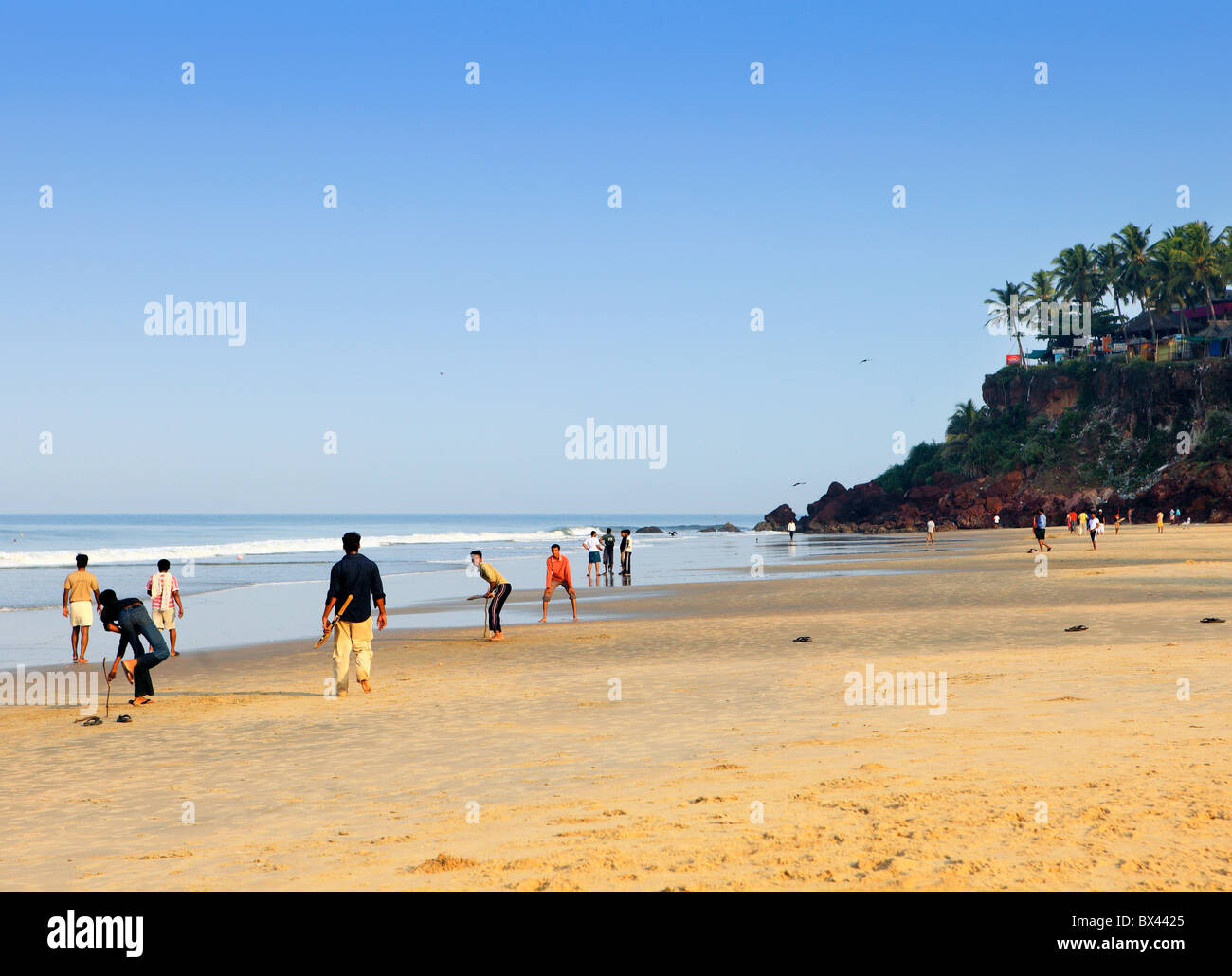 Young Indians develop their cricketing skills on the beach at Varkala, Kerala, on a Sunday morning. - Stock Image