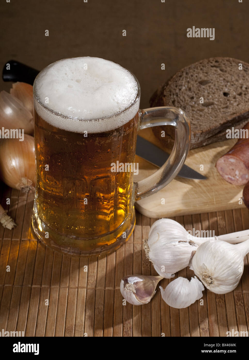 beer with garlic and sausage - Stock Image