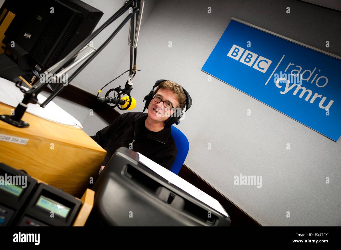 Welsh DJ GERAINT LLOYD in the BBC Radio wales regional studio Aberystwyth UK - Stock Image
