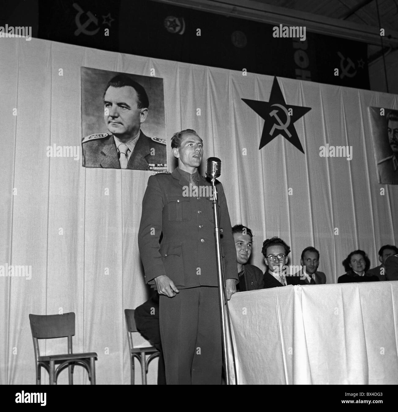 Emil Zatopek Olympic gold medalist is shown here with portrait of Communist leader Klement Gottwald as a faithful - Stock Image