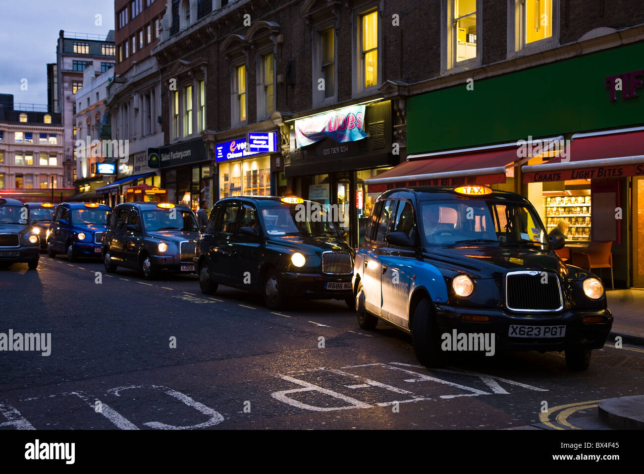 Row of black cabs taxis near Liverpoool Street Station, London, UK Stock Photo