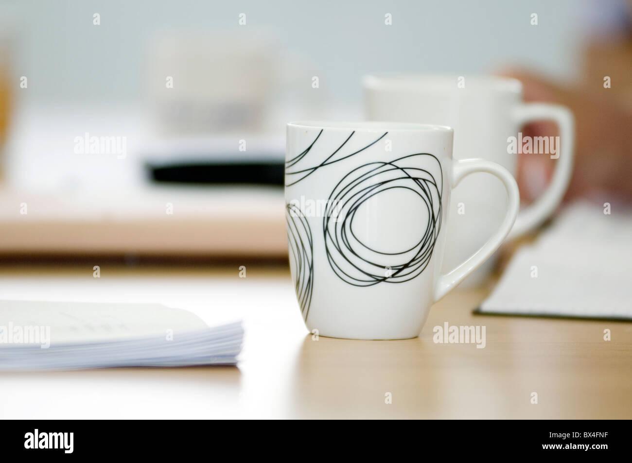coffee mug mugs cups cup break tea refreshments business meeting drink drinks drinking breaks work at work working - Stock Image