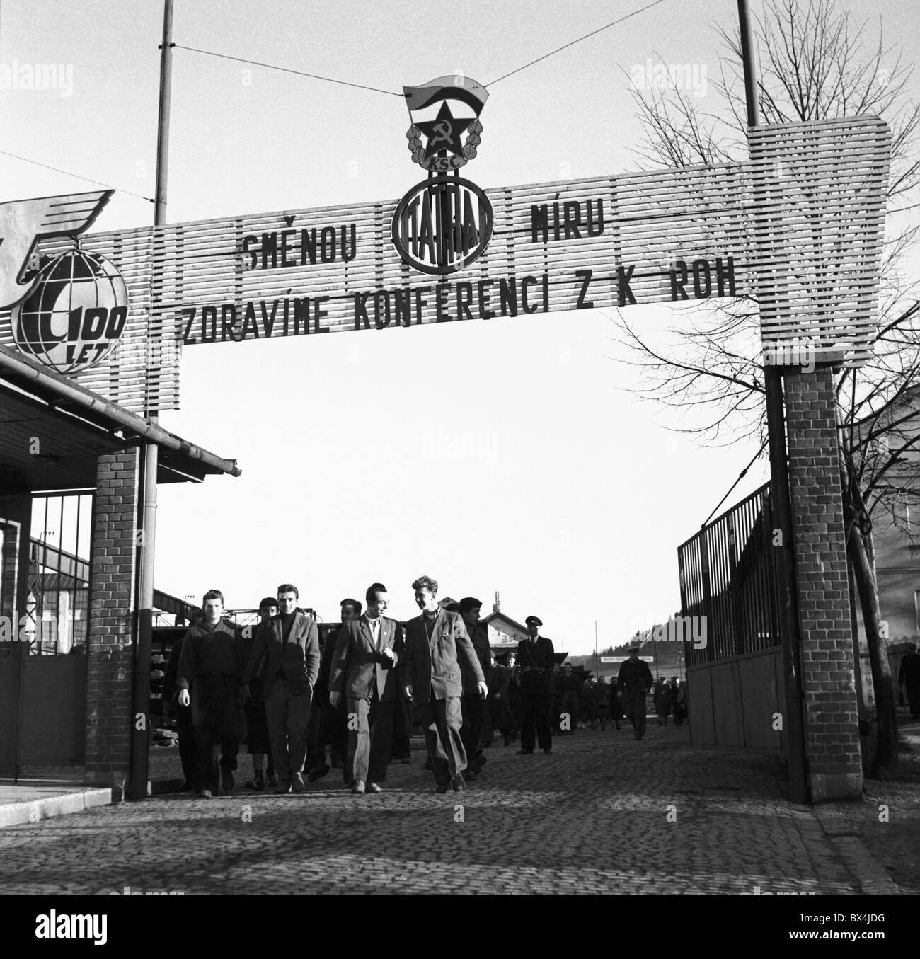 Koprivnice - Czechoslovakia, 1950.Tatra (a.k.a. Tatraplan) automobile plant workers going to their shift. CTK Vintage - Stock Image