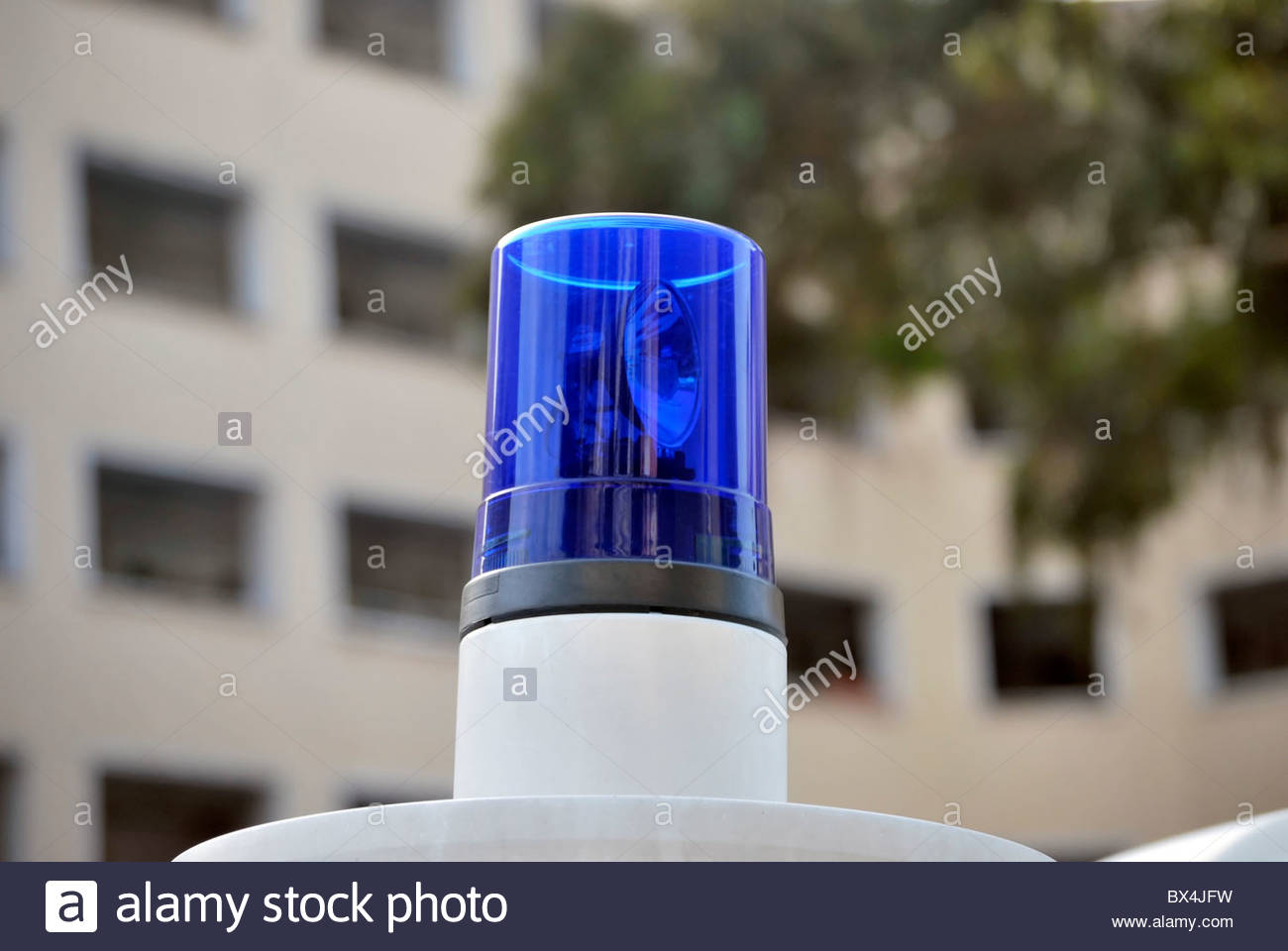 Blue emergency siren. Alarm and danger concept - Stock Image