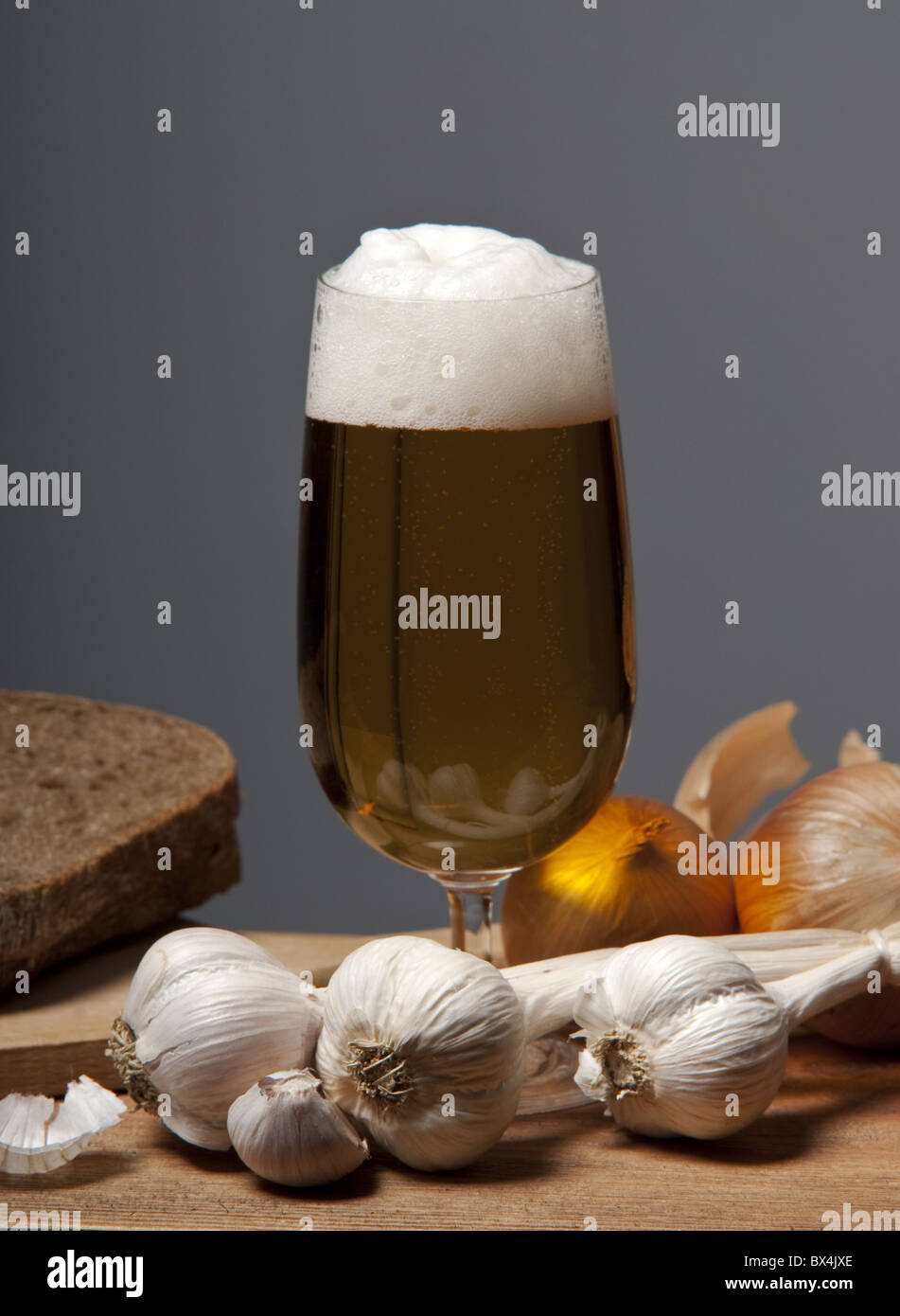 glass of beer with garlic - Stock Image