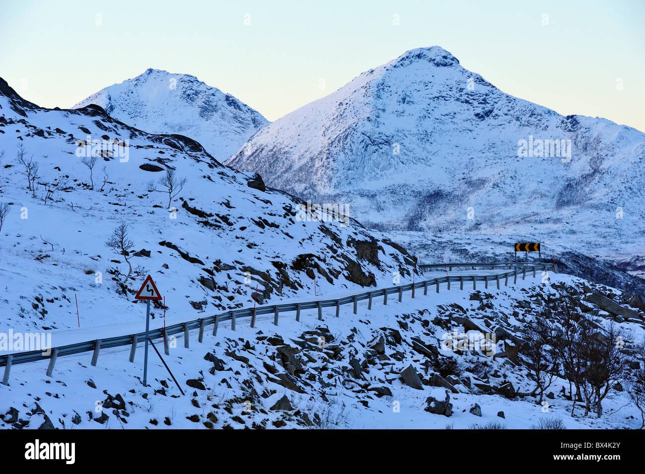 Curvy, narrow winter road in North Norway. - Stock Image