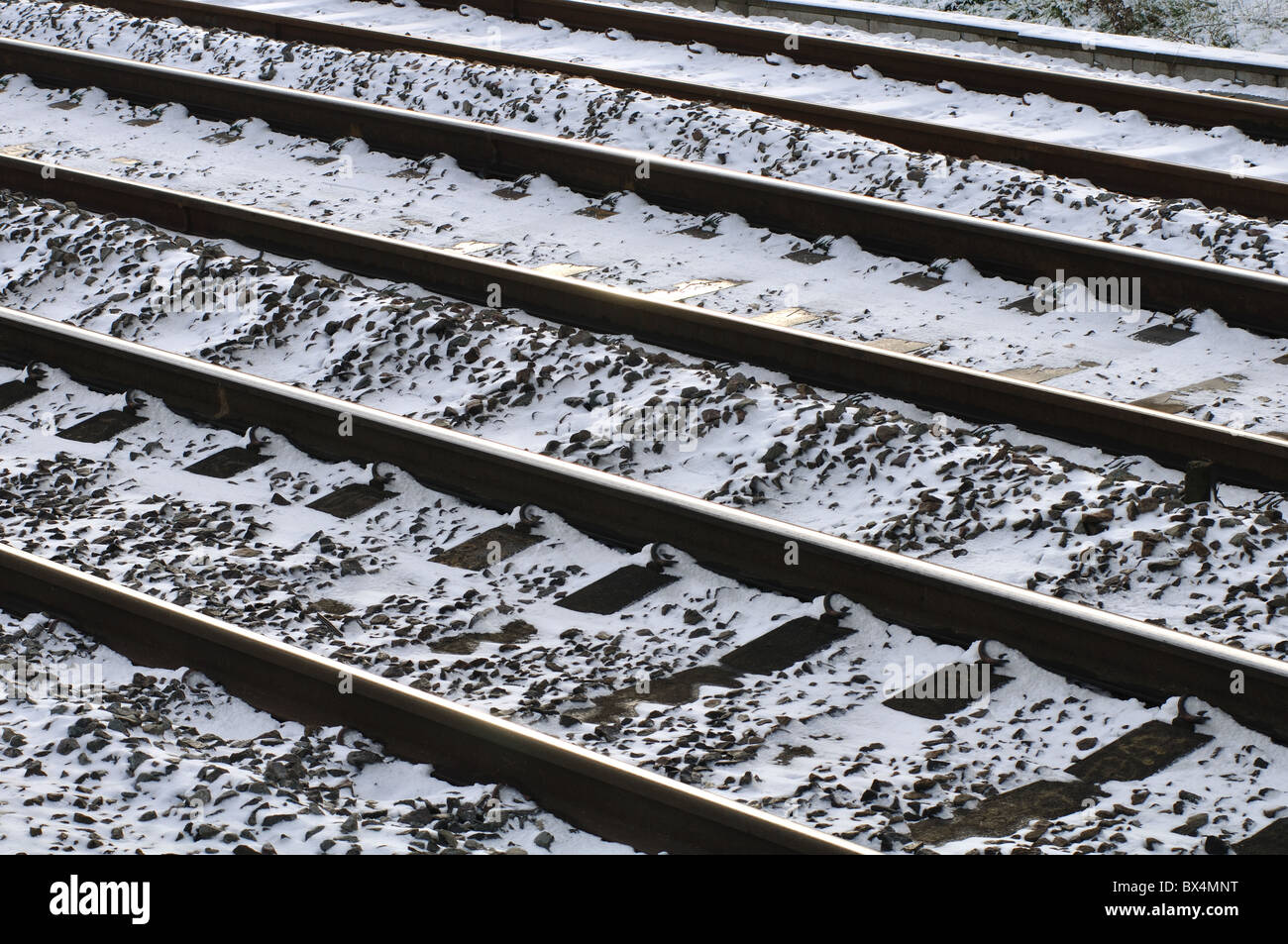 Railway lines in snowy conditions, UK - Stock Image