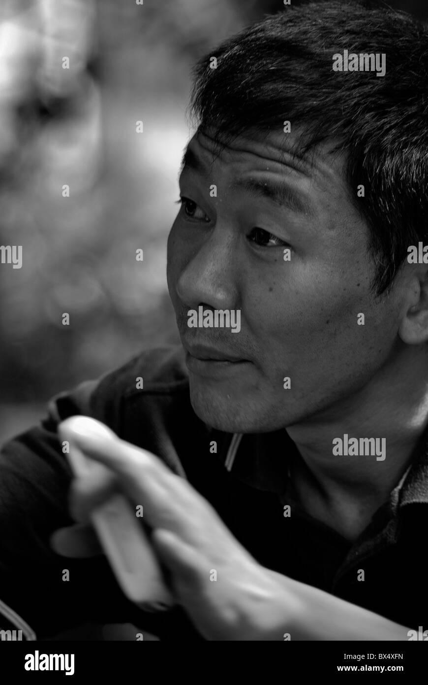 Sichuan, China - Village mayor praising development programs - Stock Image