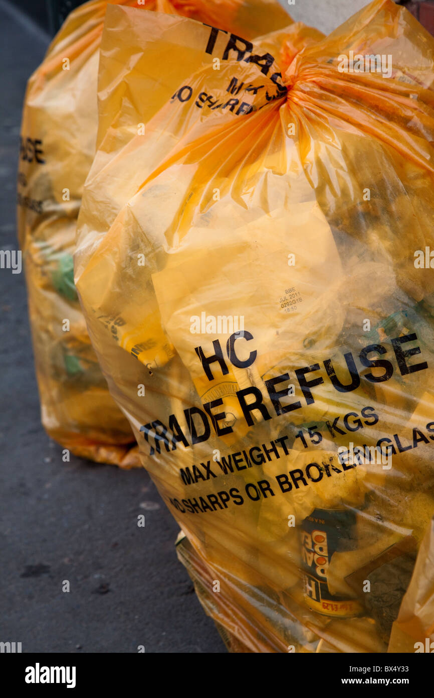 Commercial waste in HC Grade Refuse bags on street Hereford England UK - Stock Image