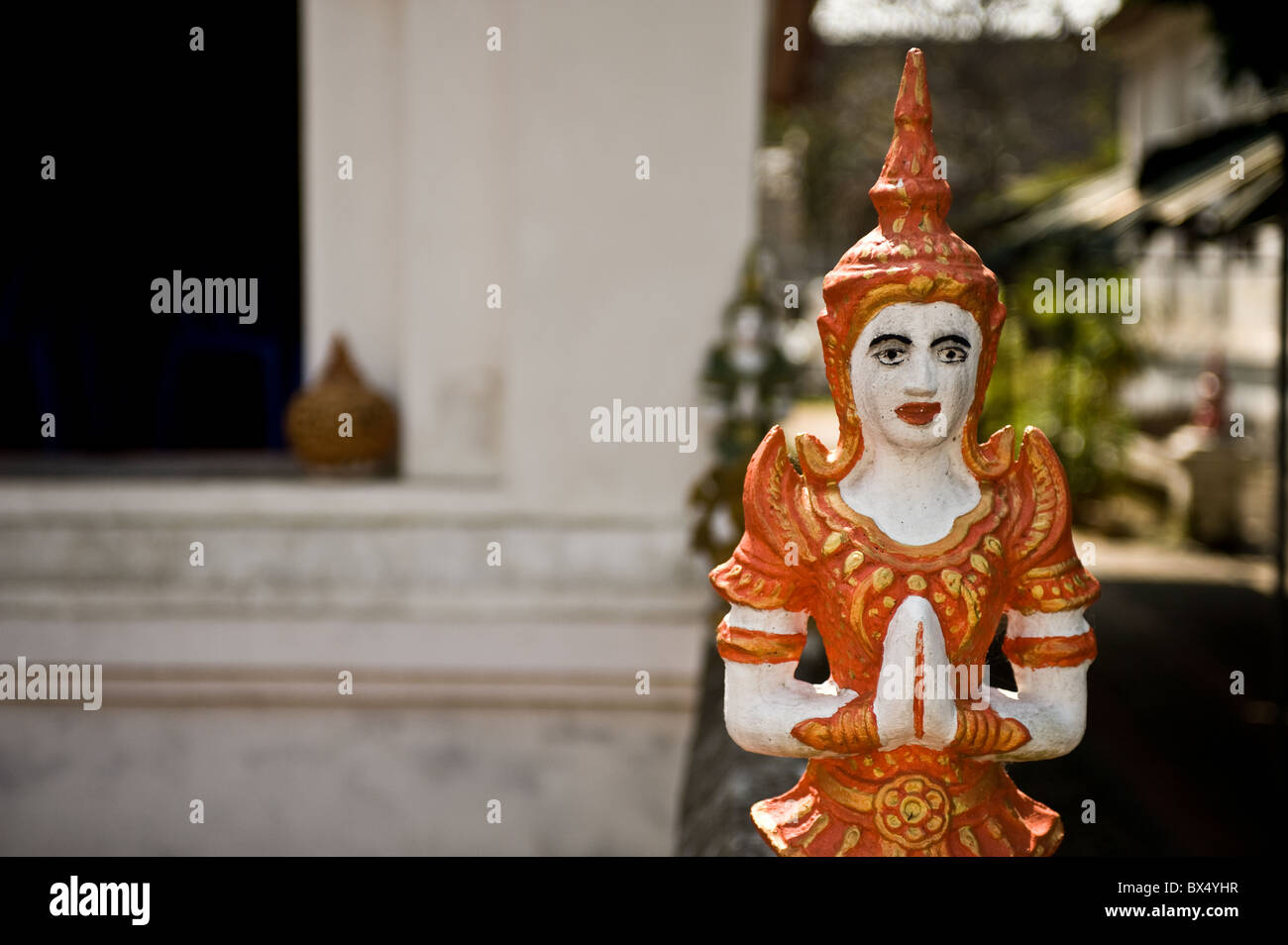 A small painted statue at Wat Buppharam in Chiang Mai in Thailand - Stock Image