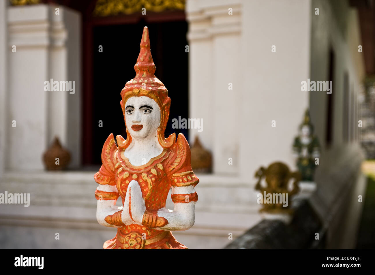 A small painted statue at Wat Buppharam in Chiang Mai in Thailand Stock Photo