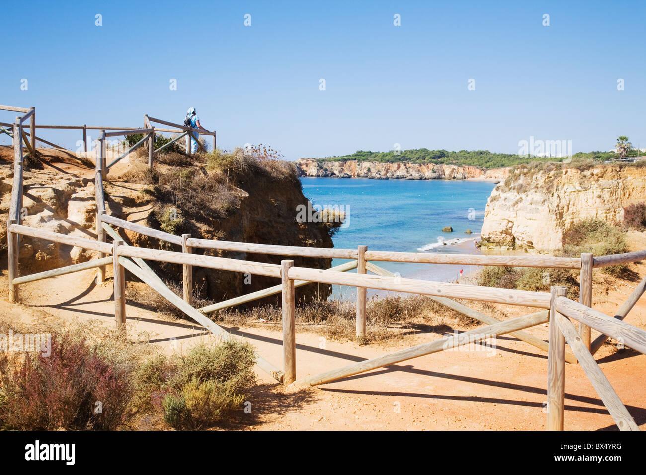 A cliff top pathway runs along the coast from 'Praia da Rocha' to 'Praia do Vau' in the Algarve, - Stock Image