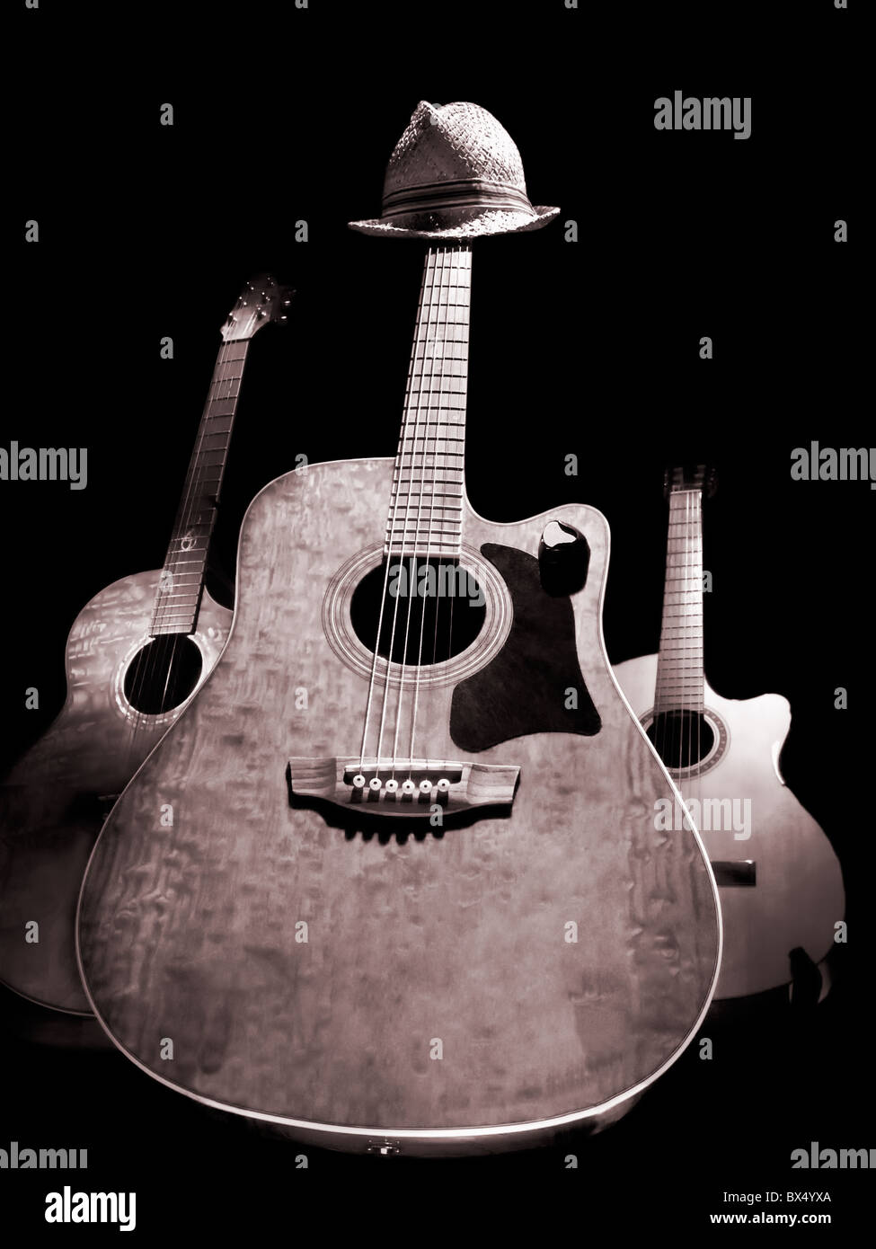 Three Acoustic Guitars Over Black Background Black And White Image