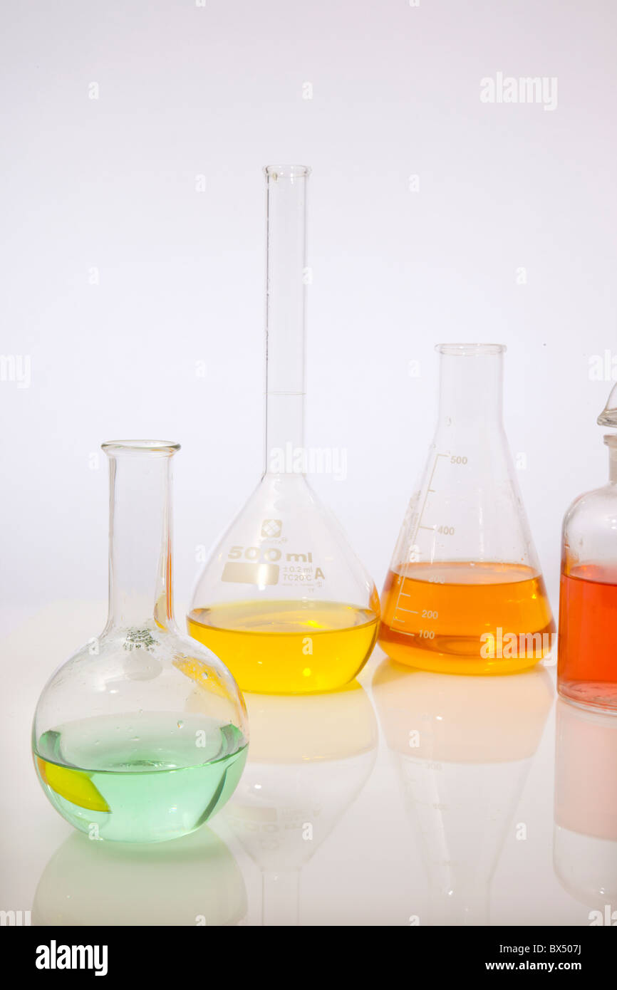 four chemistry flasks on white - Stock Image