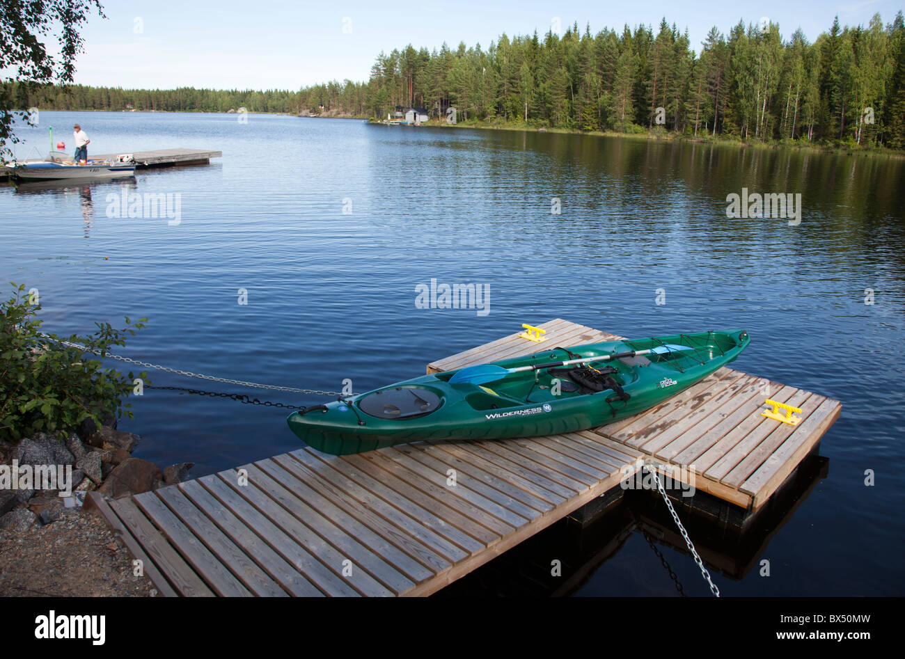 Wilderness Systems Ride 135 sit-on-top kayak beached to a jetty , Finland - Stock Image