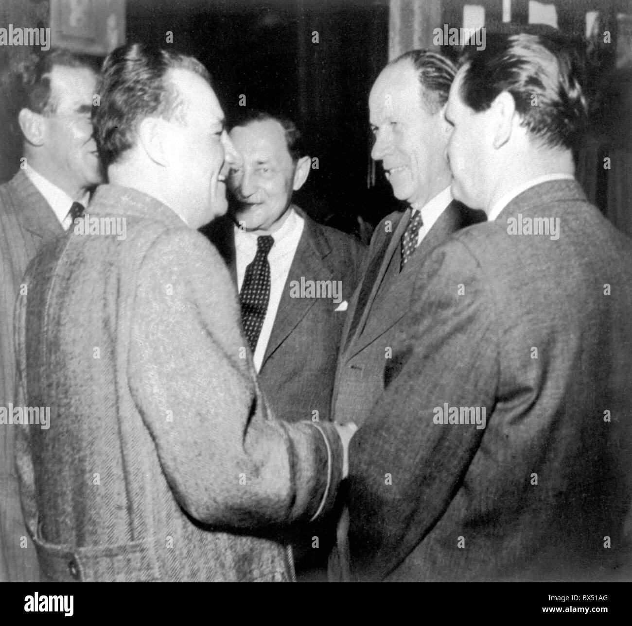 Czechoslovak President K.Gottwald talks to Czechoslovak Prime Minister Antonin Zapotocky (2nd from right) and his - Stock Image