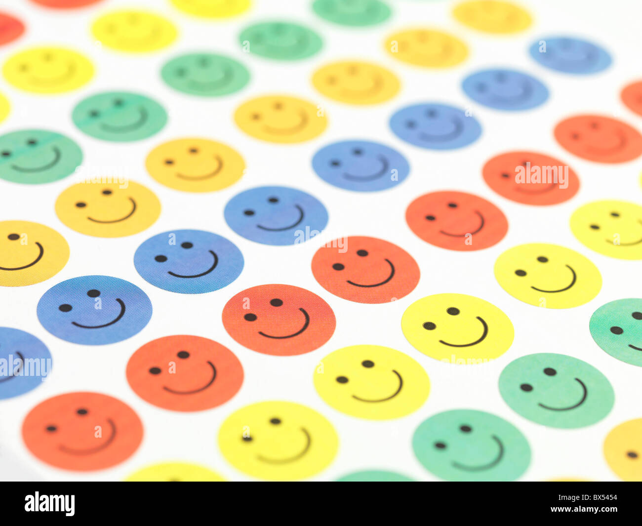 Smiley face stickers - Stock Image