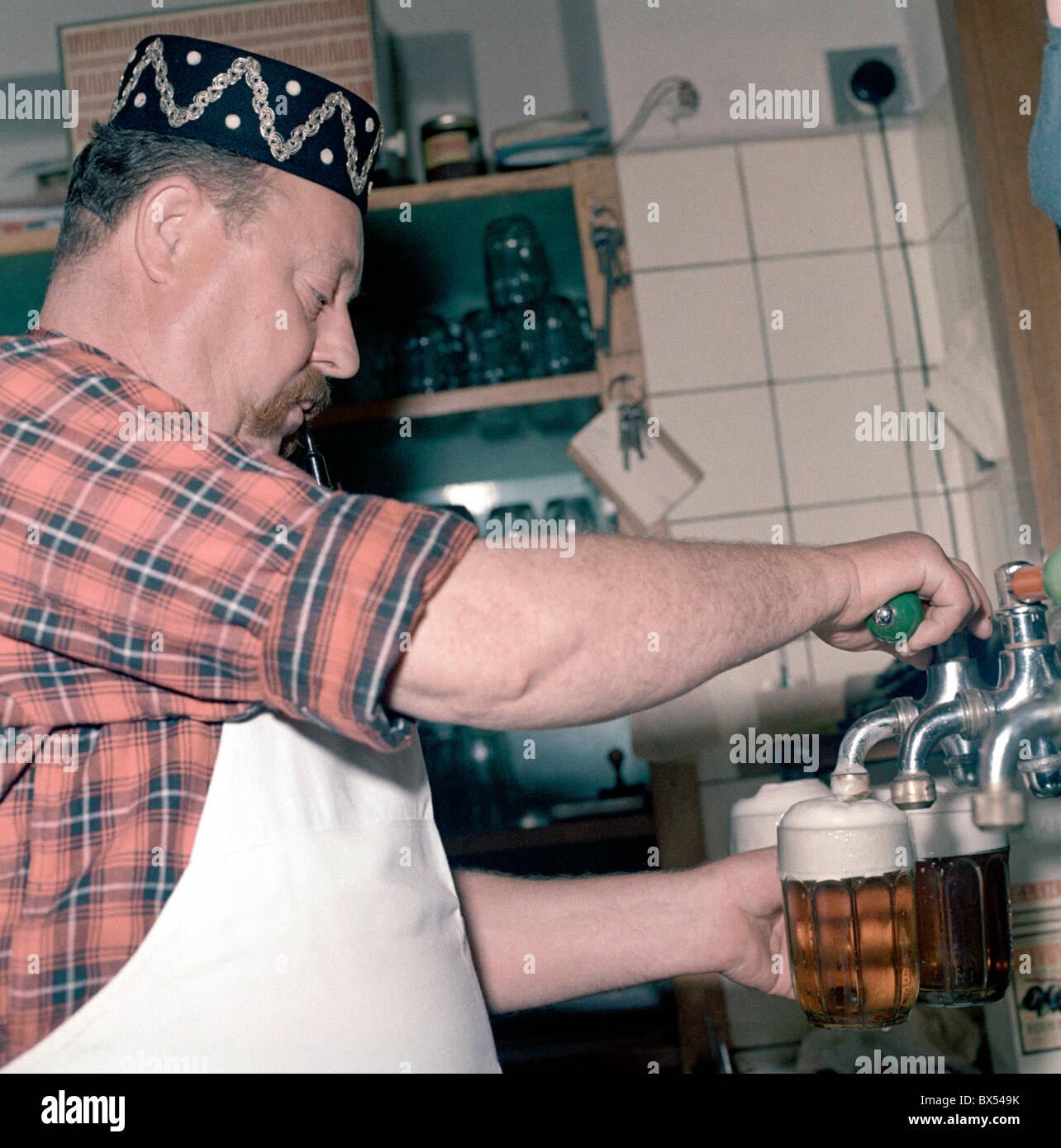 innkeeper, landlord, bartender, draught draft tap beer, glass, pipe, cap, pub, restaurant U Kalicha, Svejk Stock Photo