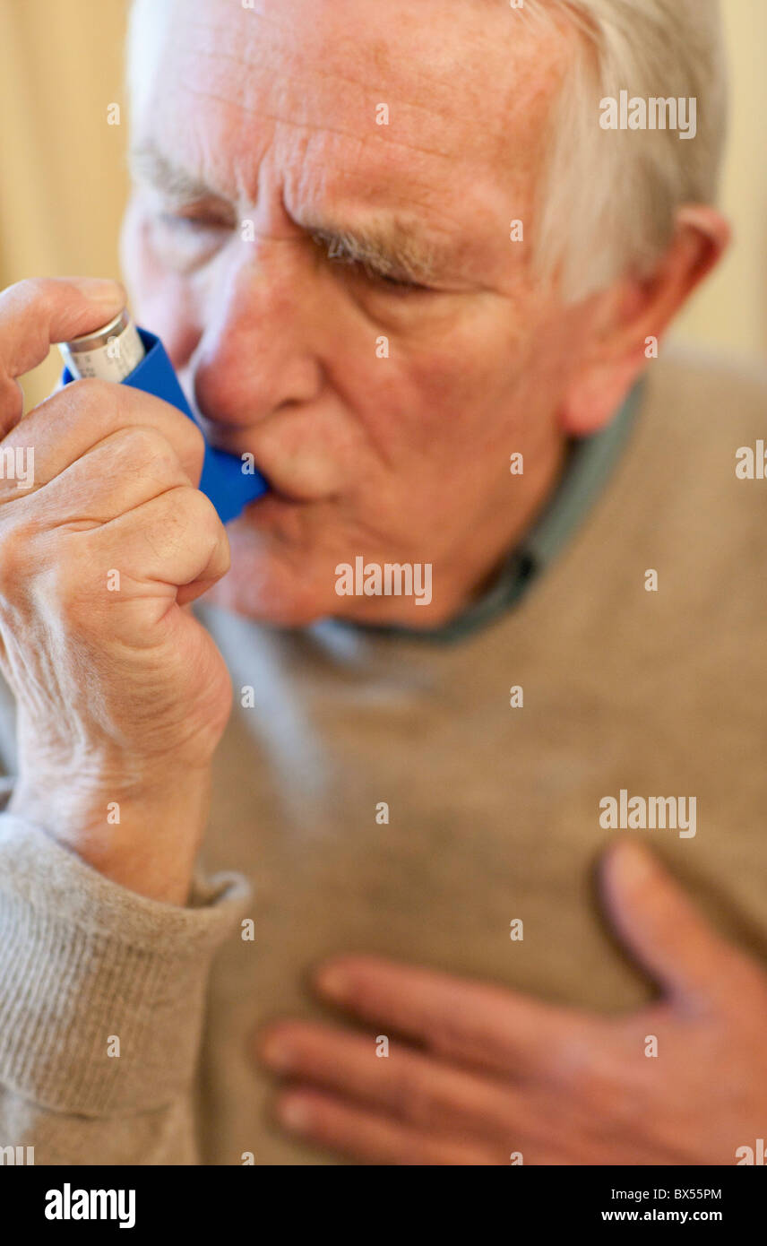 Asthma inhaler use - Stock Image