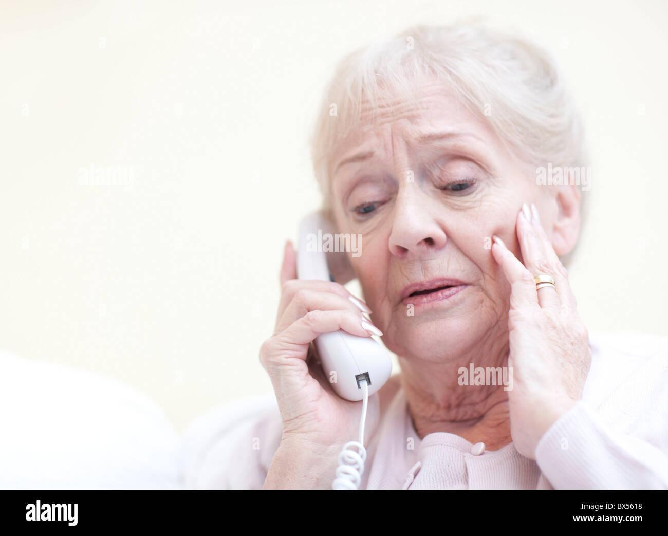 Senior woman talking on the telephone - Stock Image
