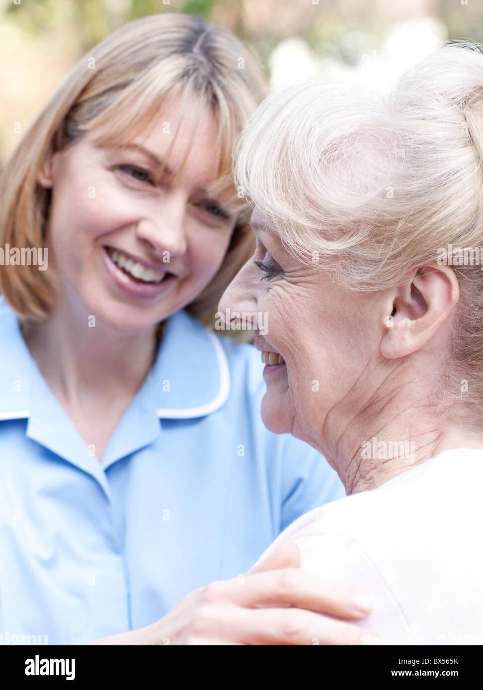 Nurse on a home visit Stock Photo