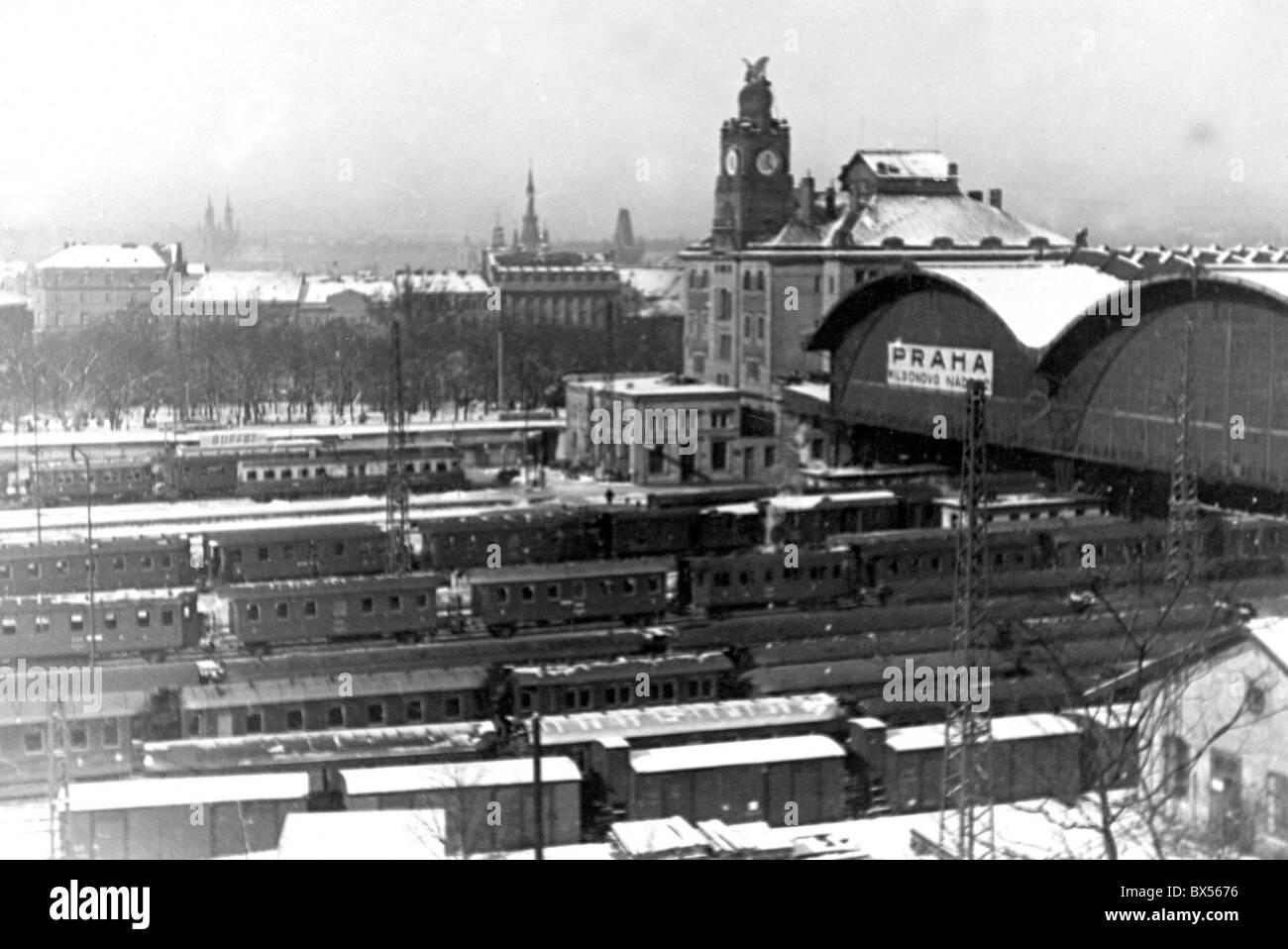 Czechoslovakia 1934, snow covered train tracks and train wagons seen at Wilson Train Sation. - Stock Image