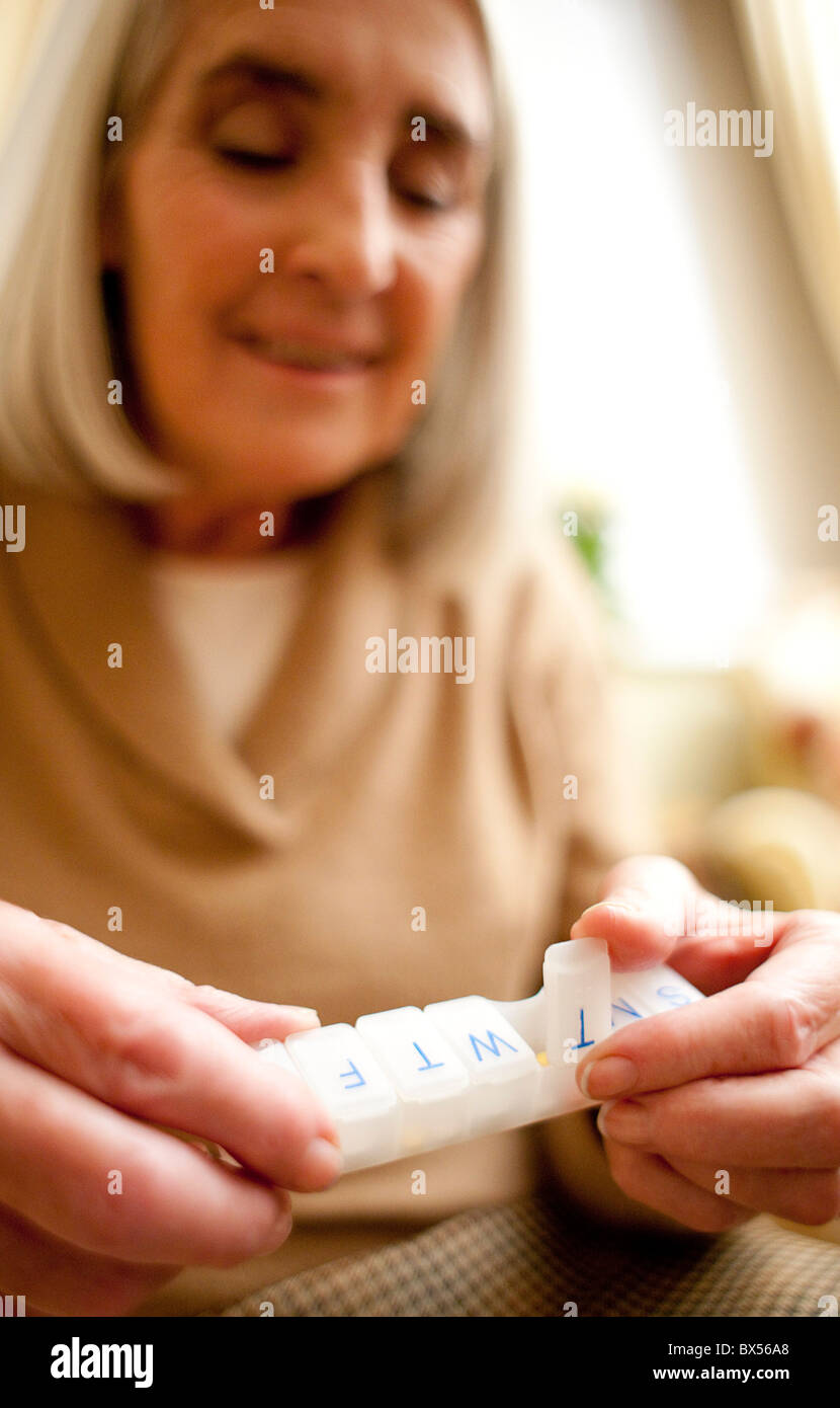 Taking medication - Stock Image