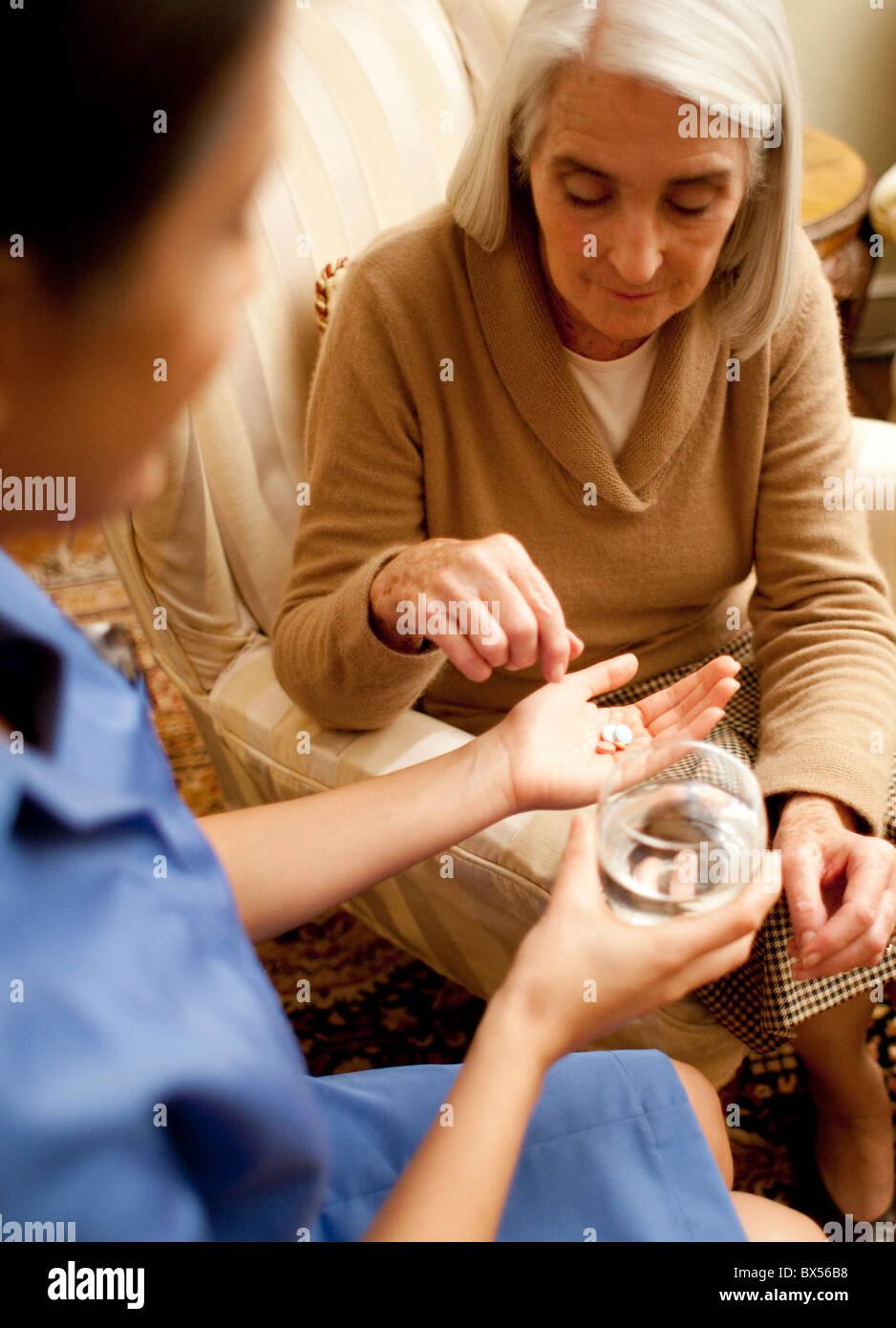 Taking medication - Stock Image
