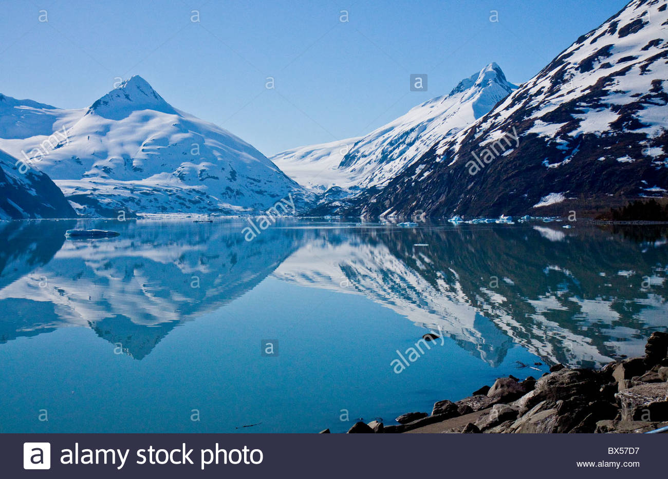 Beautiful reflections of the snow covered mountains in Portage Lake - Stock Image
