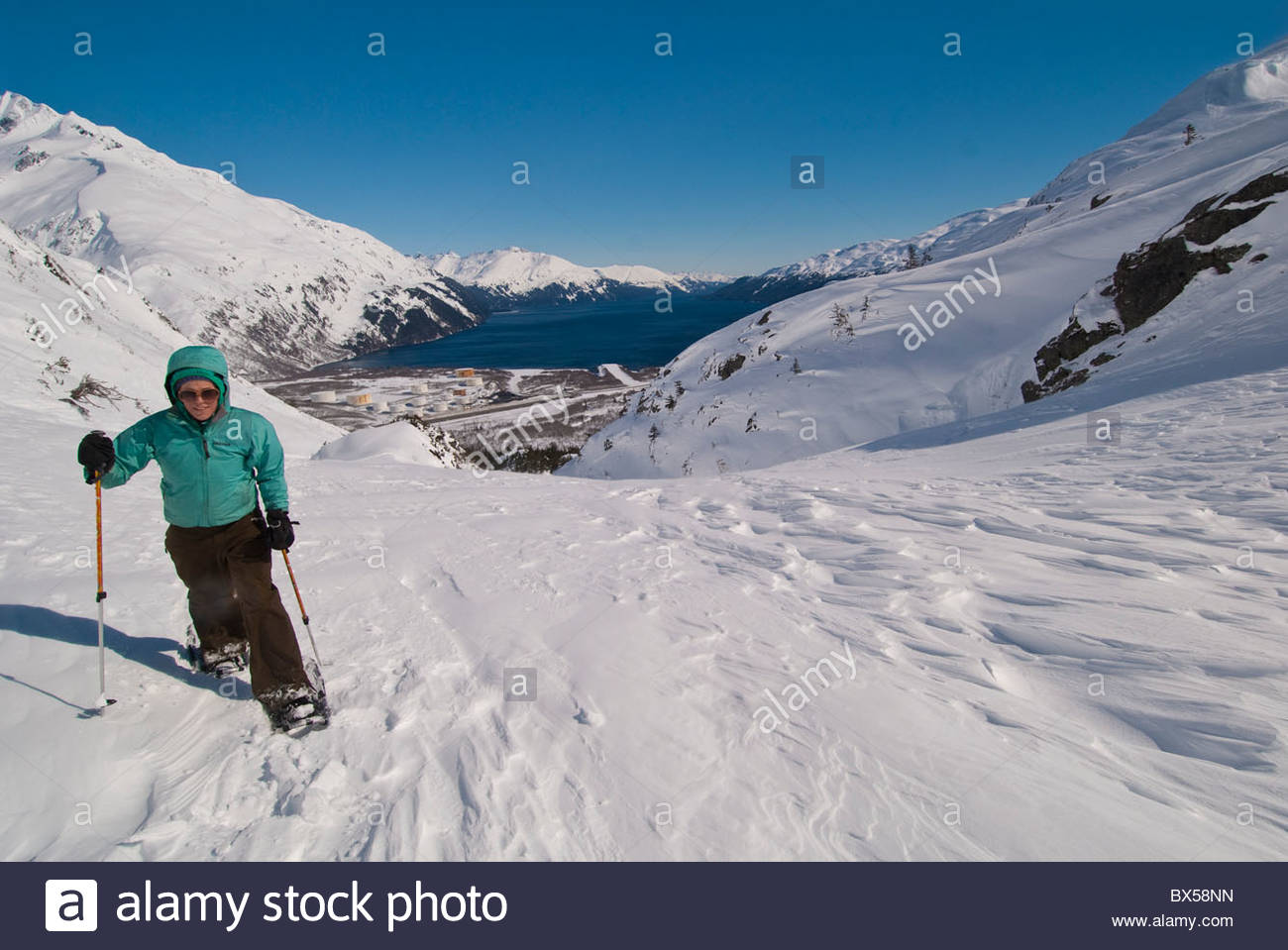 Alaska, Portage Pass in the Chugach National Forest from Whittier to Portage Lake in winter with snowshoes. Stock Photo