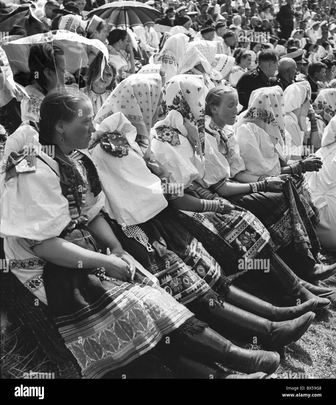 Czechoslovakia 1945. Women from all Slavic countries in traditional folk dresses gather near Devin Castle in Slovakia - Stock Image
