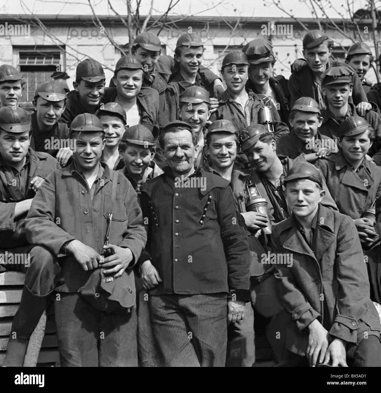 Czechoslovakia - Most, 1950. Young coalminers pose for photo with their forman. CTK Vintage Photo - Stock Image