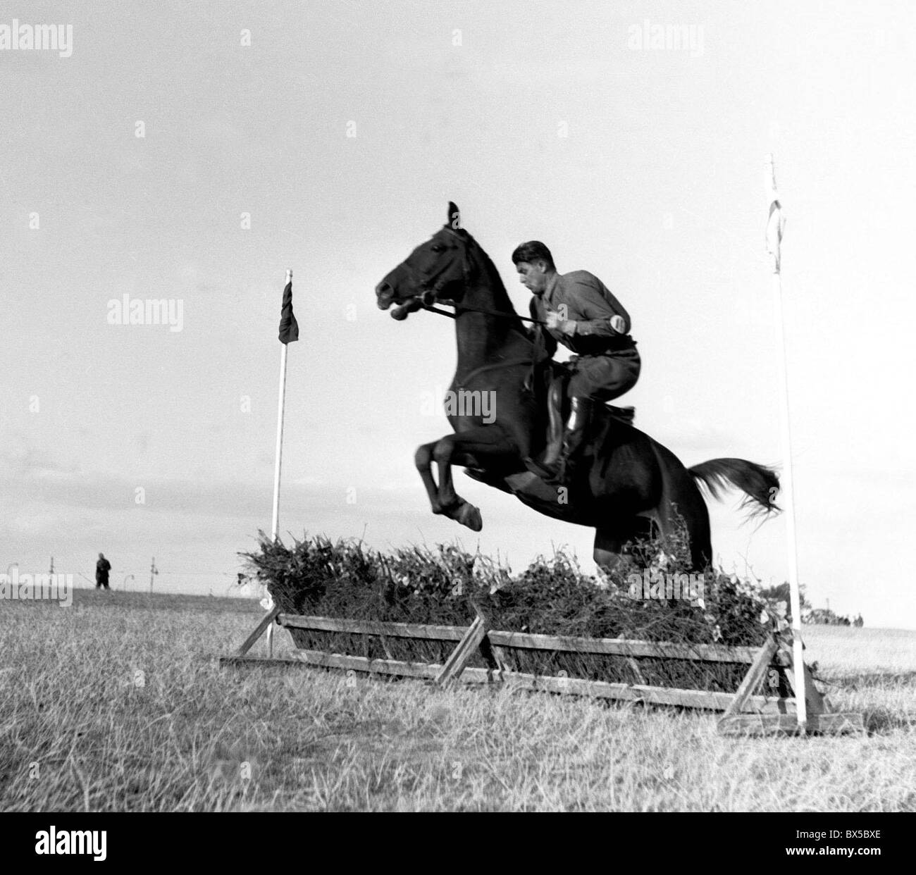 Prague 1947, horse with rider jump over obstacle during race