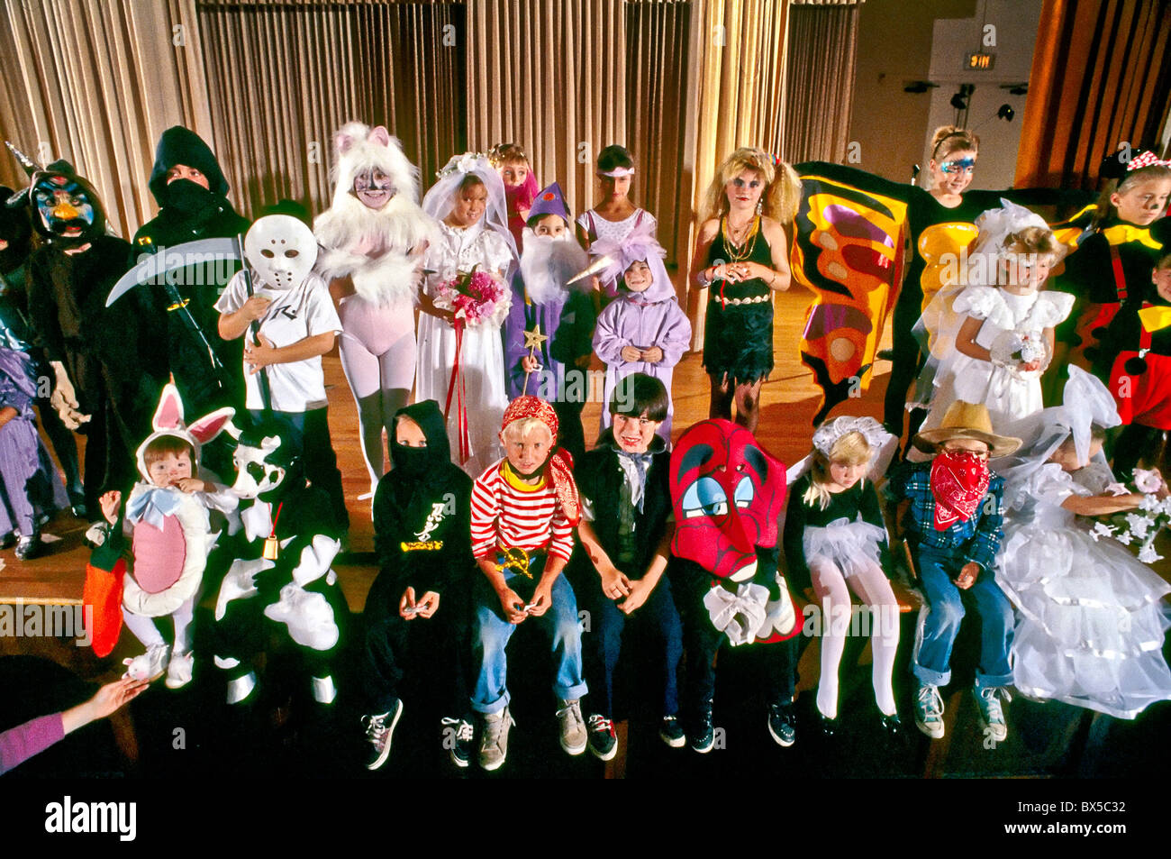 Children are dressed in Halloween costumes at a San Clemente California costume competition. - Stock Image