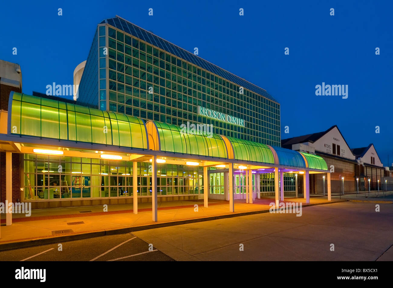 Cradle of Aviation Museum night exterior with 2 historic Mitchel Field Hangars at far side, Long Island, New York, - Stock Image