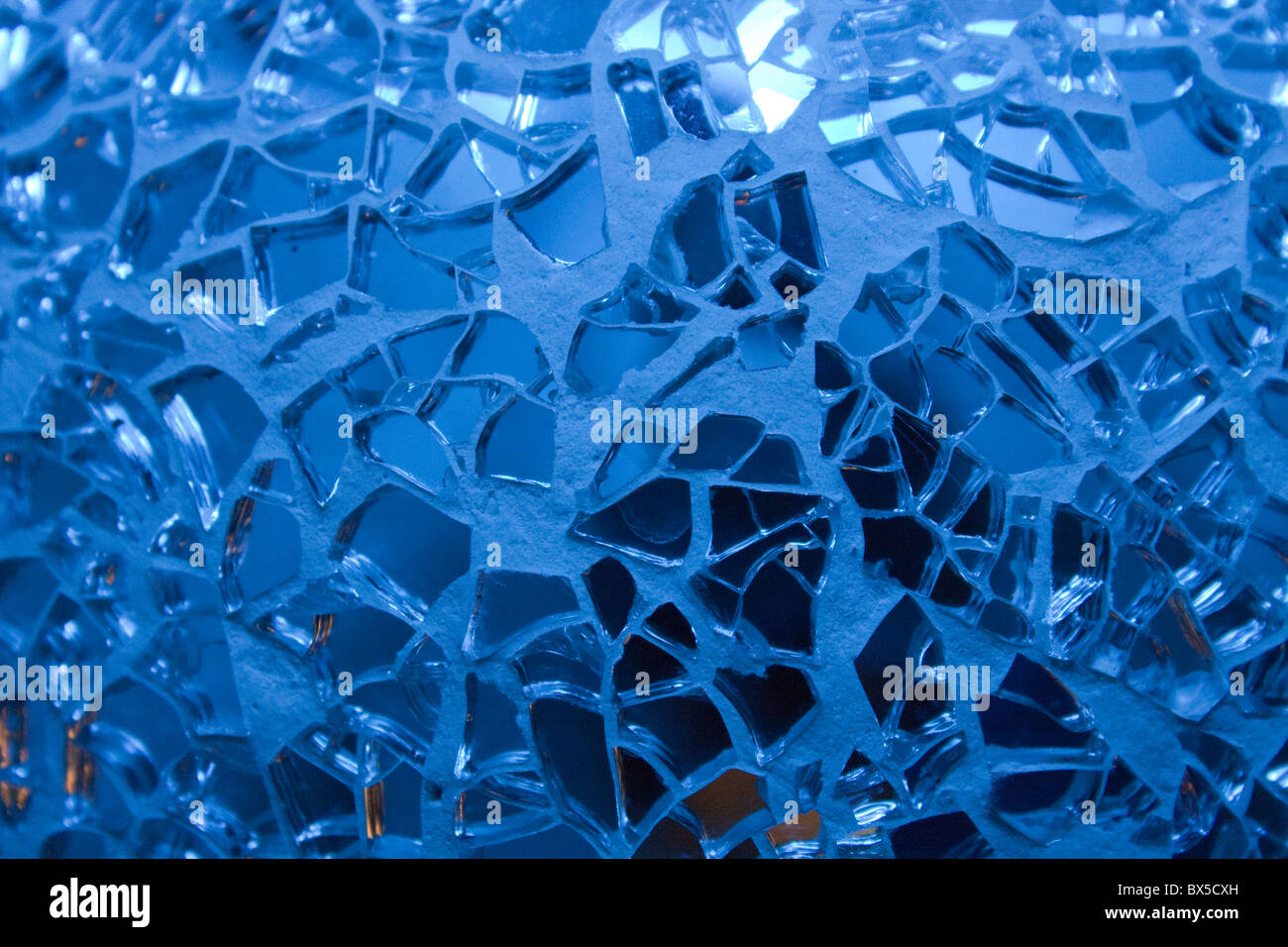 Abstract blue cracked glass background - Stock Image