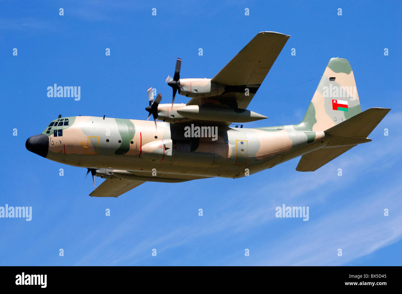 Lockheed C-130H Hercules transport plane operated by the Oman Air Force departing RAF Fairford - Stock Image