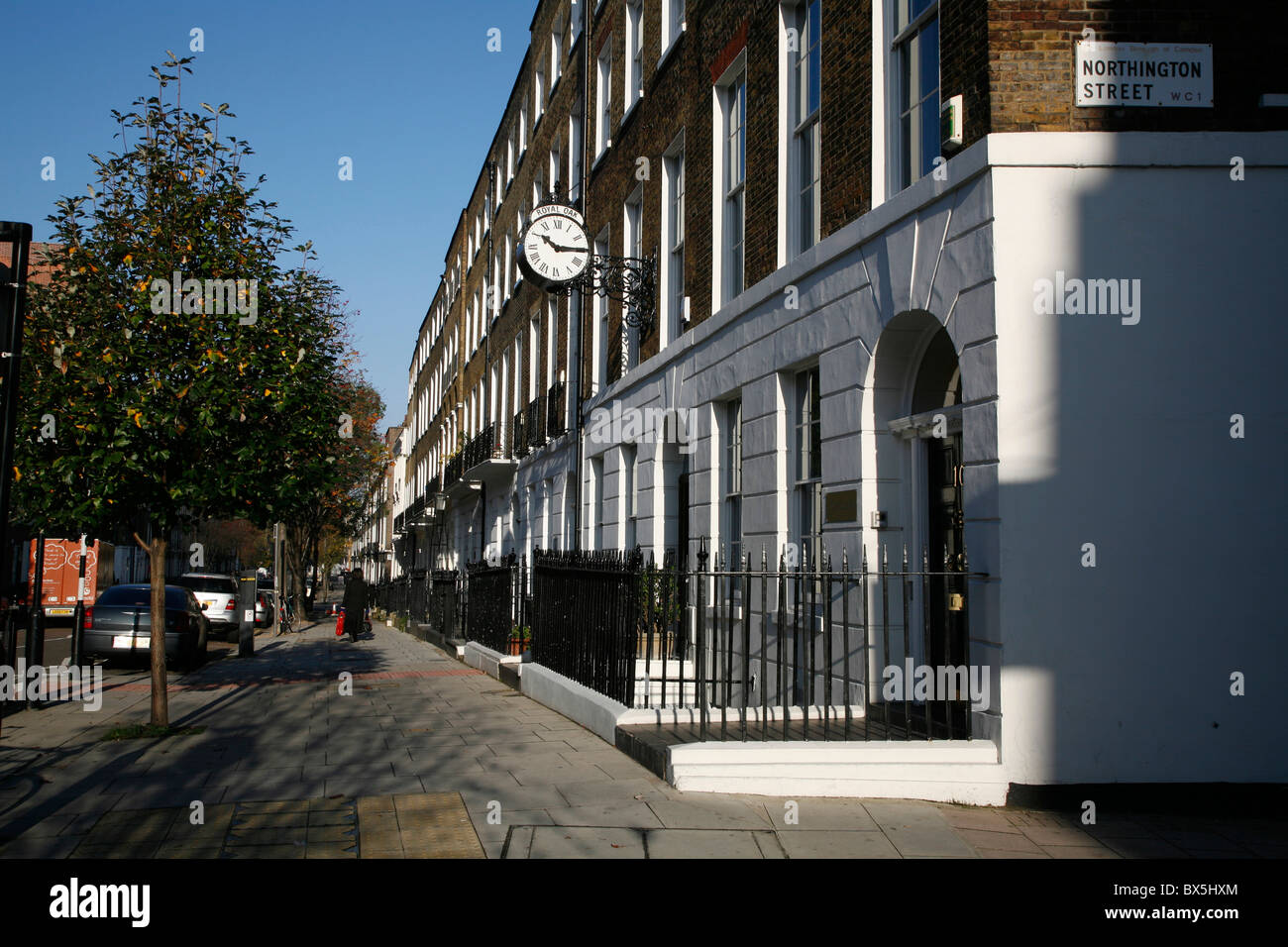 Terraced Georgian housing on St John Street, Bloomsbury, London, UK - Stock Image
