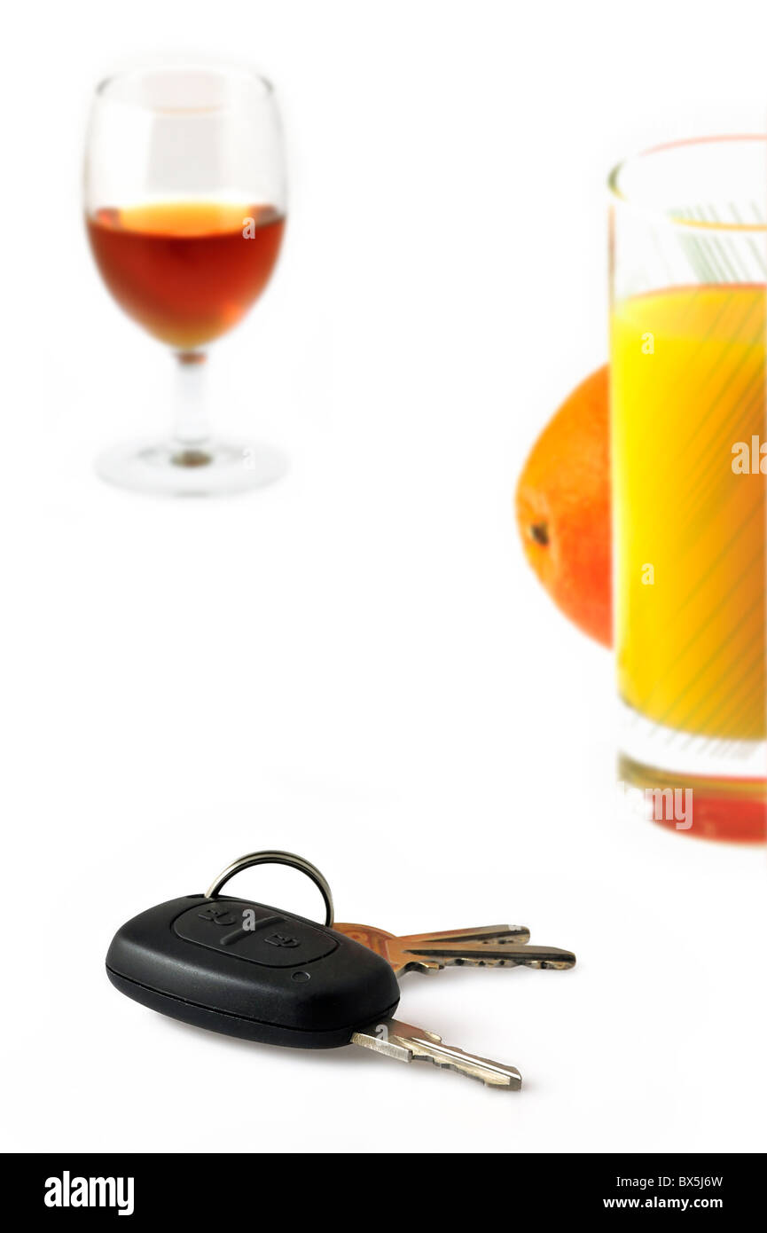 Car key, non-alcoholic soft drink and alcohol as conceptual subjects to illustrate responsible driving Stock Photo