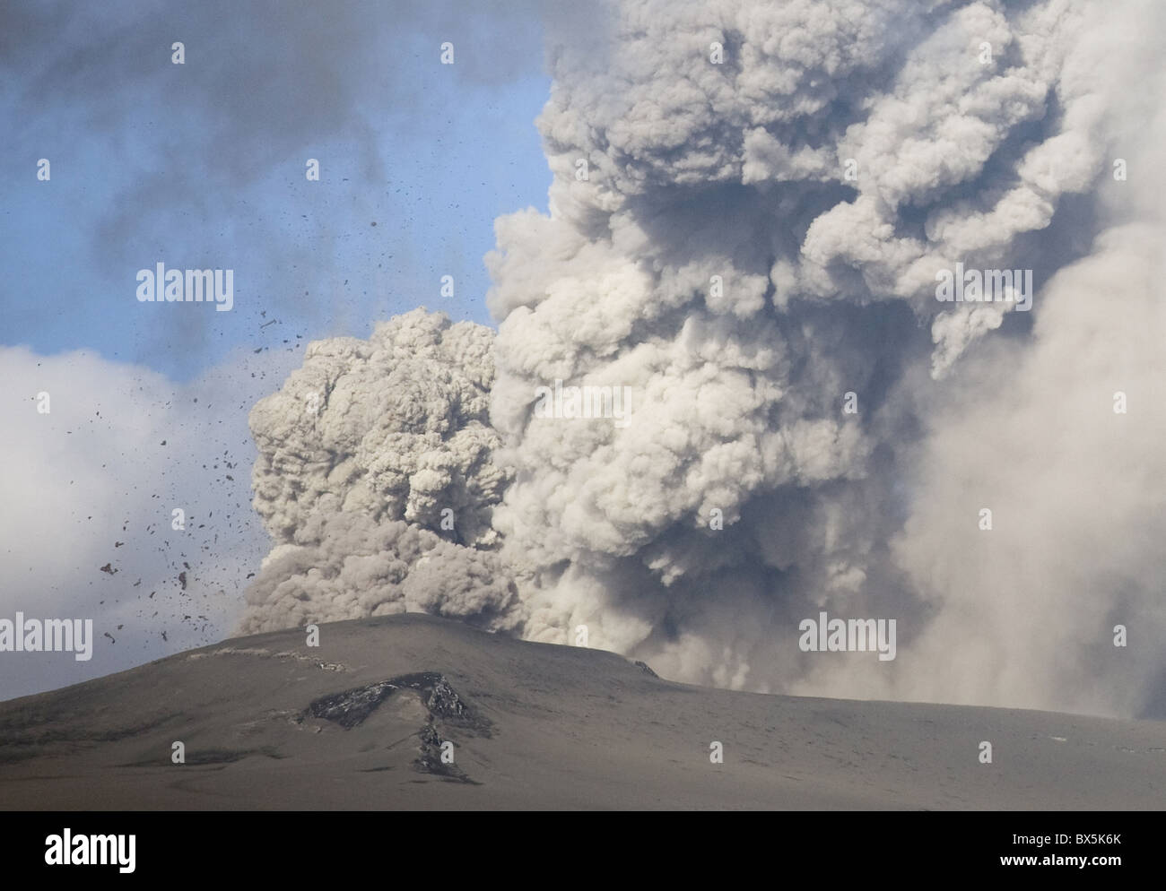 Eyjafjallajokull eruption showing billowing ash plume and rocks exploding into the sky of southern Iceland, Iceland - Stock Image