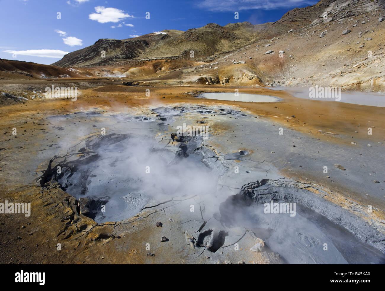 Dramatic volcanic landscape with boiling mudpools in geothermal area on Reykjanes Peninsula, near Keflavik, Iceland - Stock Image