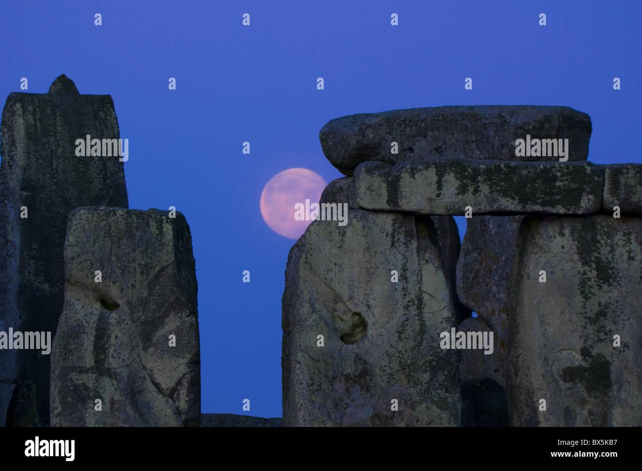 Moon behind Stonehenge, UNESCO World Heritage Site, Wiltshire, England,  United Kingdom, Europe - Stock Image