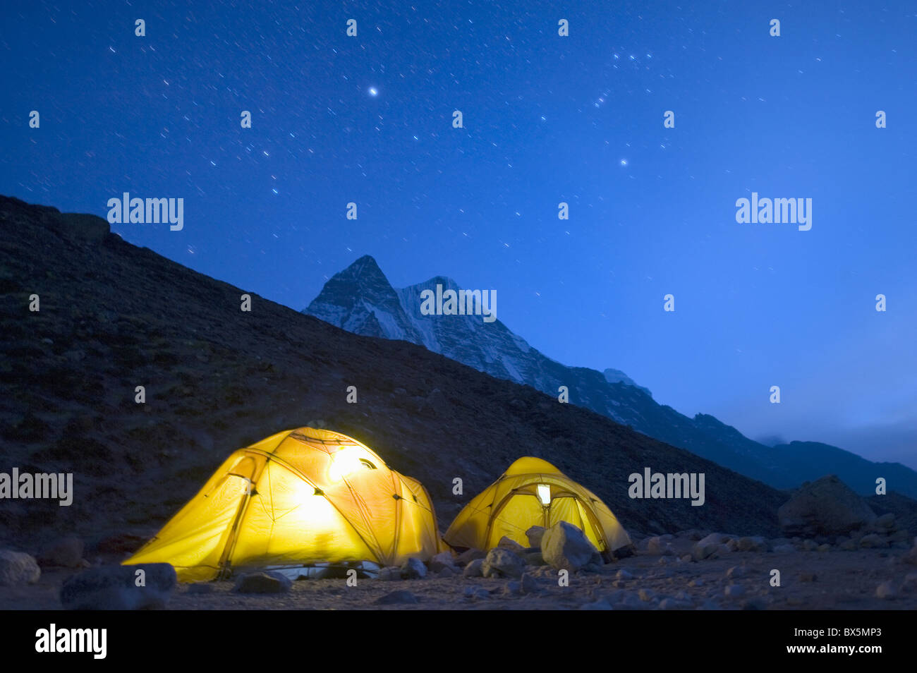 Illuminated tents at Island Peak Base Camp, Solu Khumbu Everest Region, Sagarmatha National Park, Himalayas, Nepal, - Stock Image