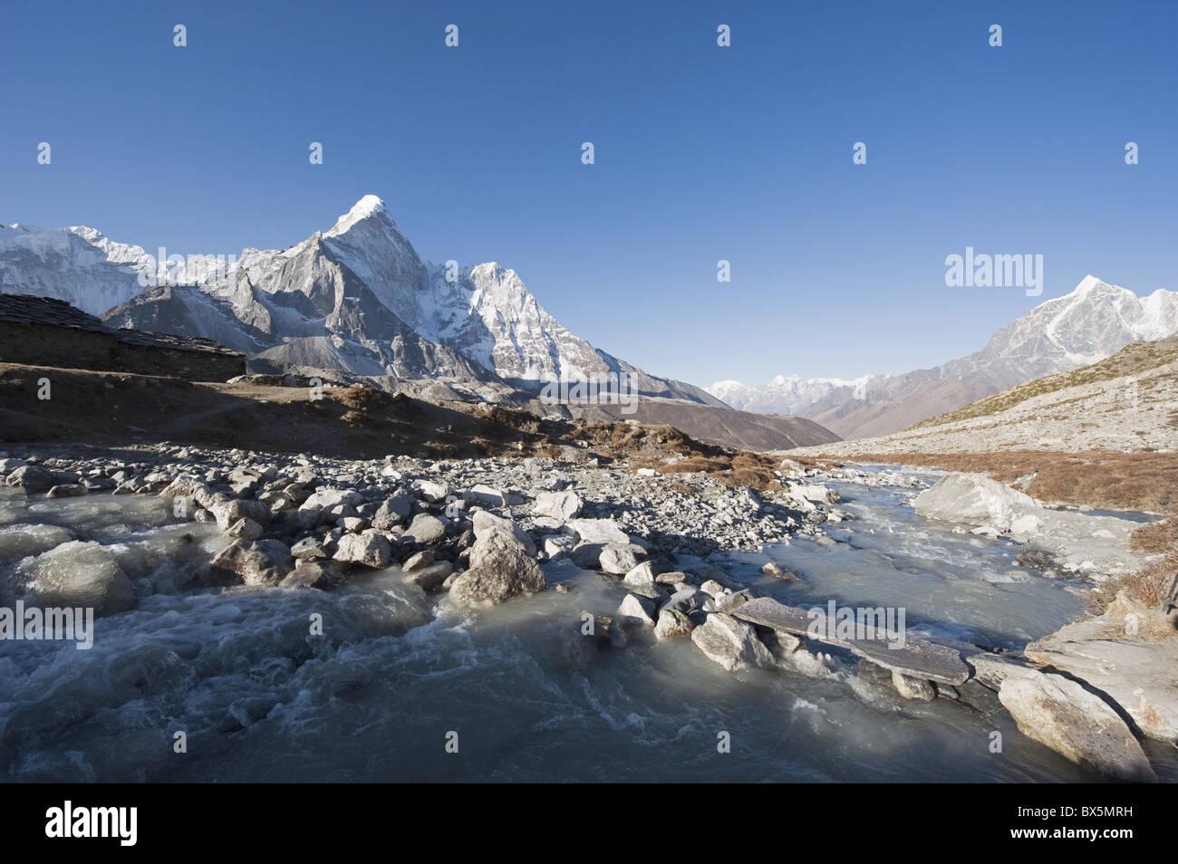 Mountain stream and Ama Dablam, 6812m, Solu Khumbu Everest Region, Sagarmatha National Park, Himalayas, Nepal, Asia - Stock Image