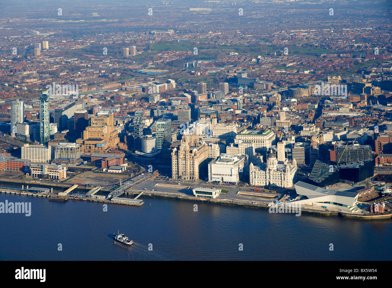 Liverpool Waterfront and the river Mersey, from the air, North West England, with the Mersey Ferry arriving - Stock Image